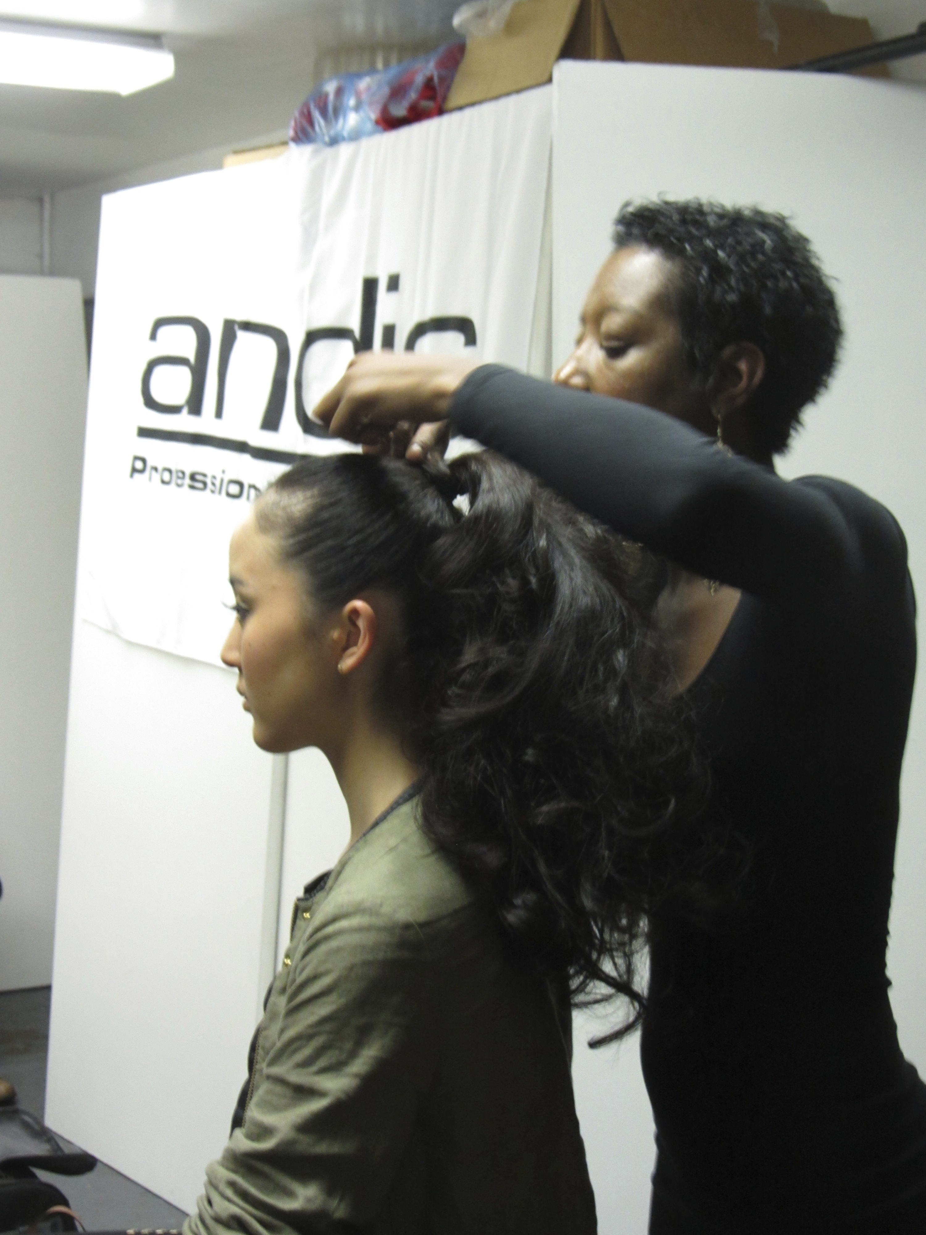 Andis stylist works on the hair for the collection.