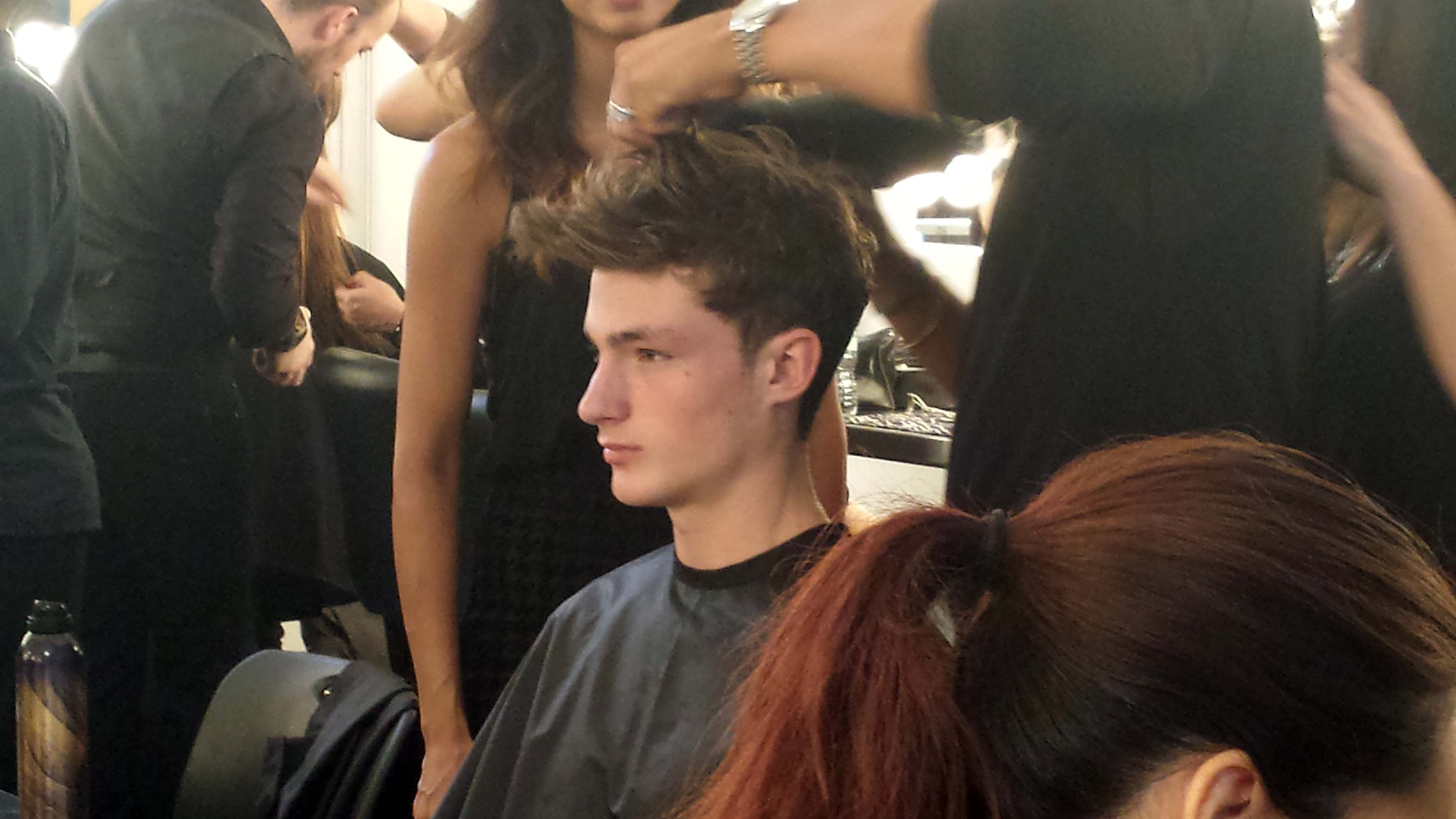 The stylist works his hands through the hair to create natural texture.