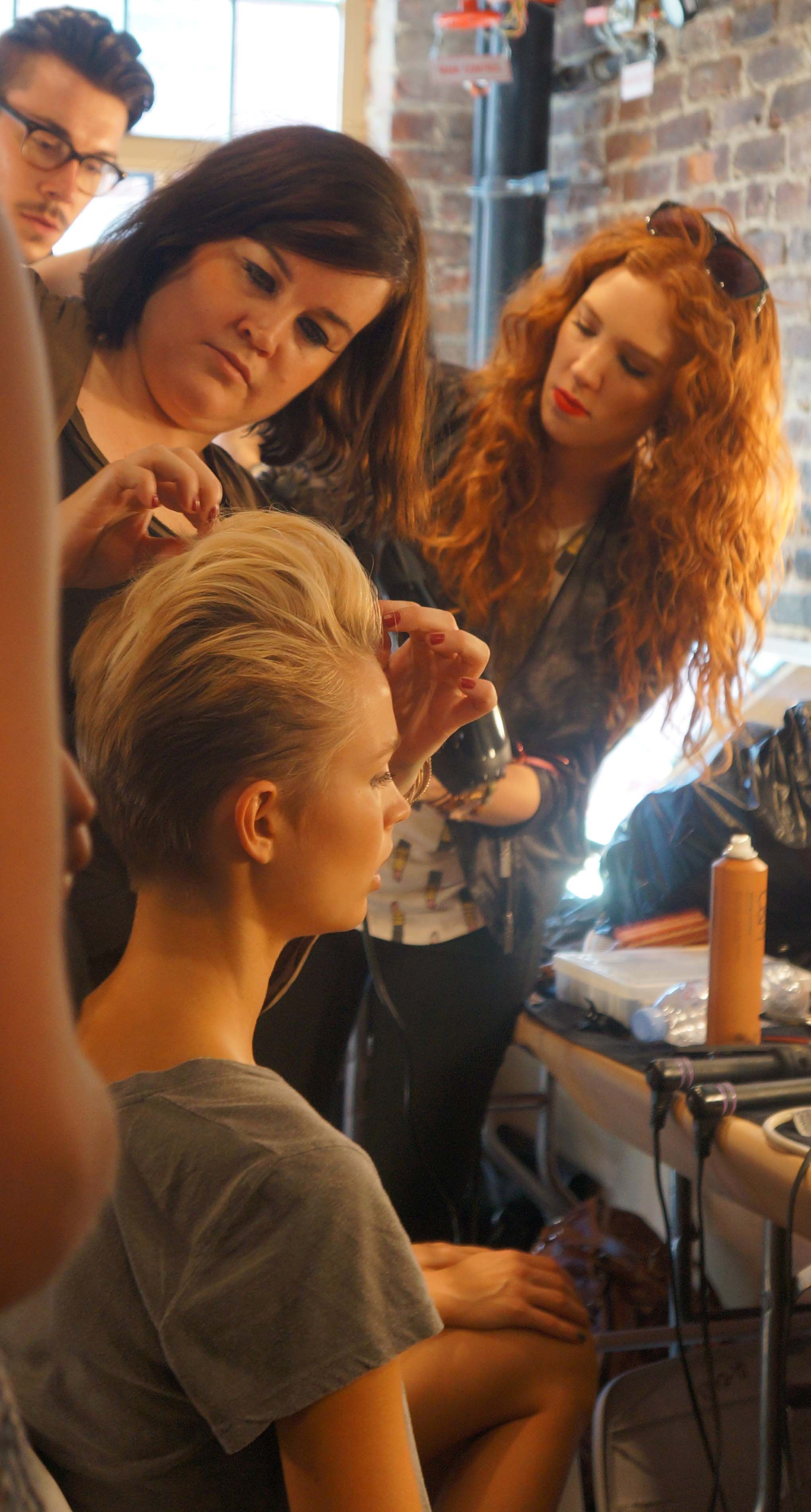 Janelle Chaplin adding some final touches on the hair