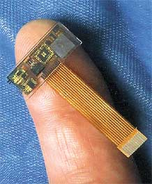 Photo 2. The fragile wiring on miniature sensors, like the submicron position sensor illustrated here, makes the case for why wireless technology will become more important as sensors shrink.
