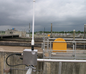 Figure 2. In this photo an MEA wireless sensor modem (foreground) continuously transmits dissolved oxygen data, eliminating the need for manual data collection.