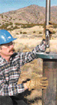 Researcher Joe Henfling field tests a Sandia high-temp downhole probe.