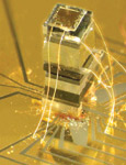The widest block in this chip-scale magnetometer is a sealed, transparent cell containing a vapor of rubidium atoms.