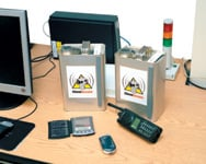 Figure 1. Custom temperature sensors and stationary and handheld RFID devices work together to provide critical event and application information on the handling, storage, and access authorization of hazardous materials at NASA's Dryden Flight Research Center. Real-time event alerts are enabled via Oracle UI's and wireless Web and short message service alerts to operations and security groups.