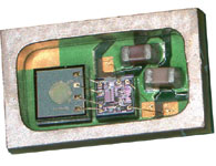 Figure 1. SiSonic condenser microphone package with lid removed; this is a first-generation version; subsequent generations have been developed