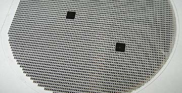 Figure 2. Thermo-optic thin-film filters are manufactured and tested on a wafer scale using techniques similar to those used to make flat panel displays.