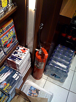 Figure 2. An empty fire extinguisher at an airport concession stand