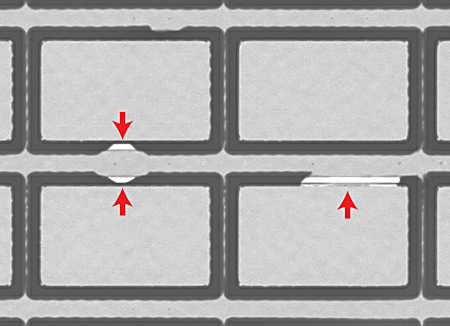 Figure 2. Acoustic image of four MEMS devices in a wafer. White areas are defects in the seals around the cavities
