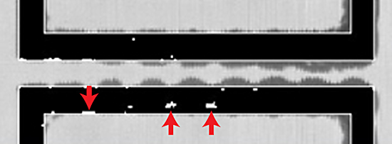 Figure 3. Small defects in the seals around two adjacent wafers
