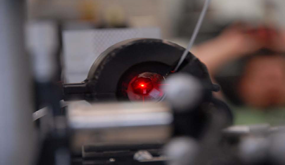Figure 1. Laser light reflecting off a test fixture containing the new damped high-shock accelerometer