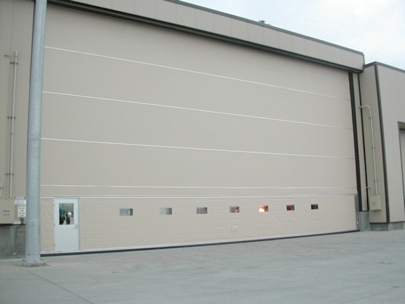 Figure 1. An aircraft hangar door with a personal cutout door at the lower left
