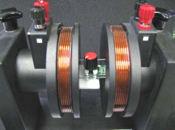 Fig. 4: An ams position sensor's operation is unaffected even by the very strong magnetic fields generated within a Helmholtz coil.