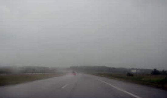 Fig. A: Inclement weather can make it difficult for vision systems to detect road markings and other vehicles.