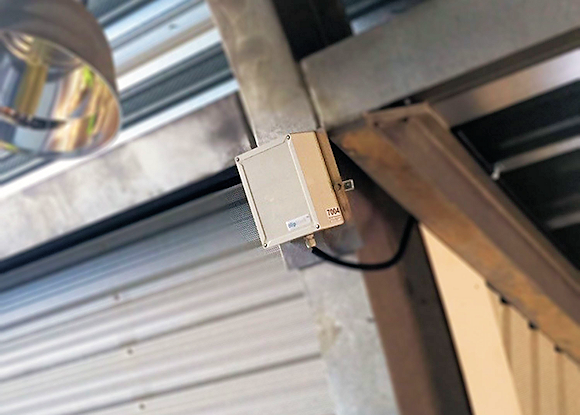 Passive and non-intrusive tracking sensor easily installs on a post.