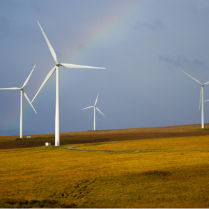 Wind turbines with a rainbow in the background