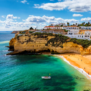 View of Carvoeiro fishing village with beautiful beach, Algarve, Portugal. View of beach in Carvoeiro town with colorful houses on coast of Portugal. The village Carvoeiro in the Algarve Portuga