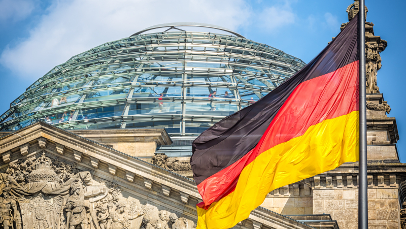 Reichstag in Berlin with German Flag