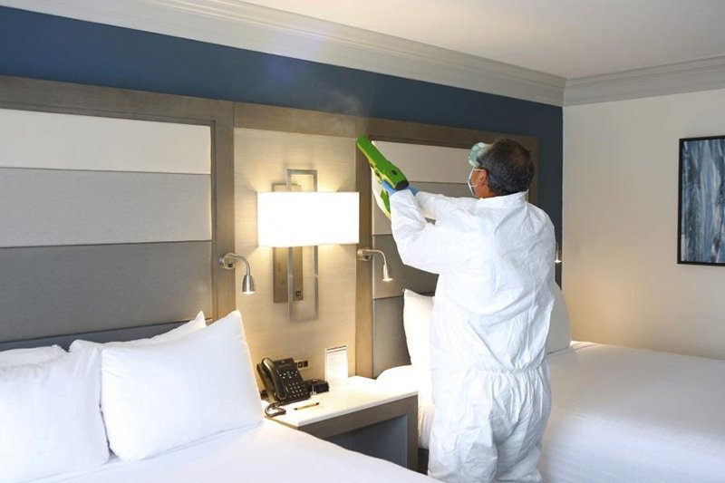 Housekeeping thoroughly sanitizes each guestroom (here at Rosen Centre) with an electrostatic sprayer that uses hospital-grade disinfectants designed to kill viruses, secured through a partnership with the experts at Ecolab®.