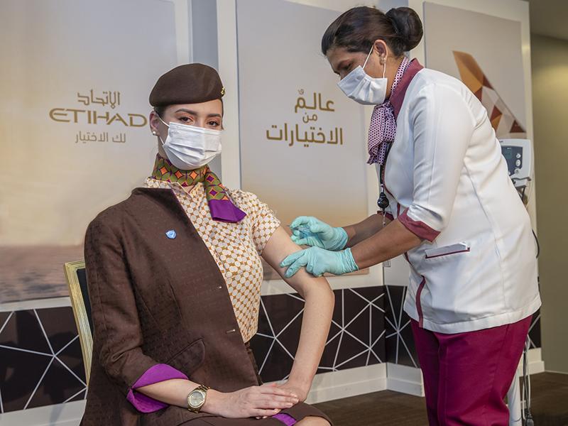 Etihad employee being vaccinated