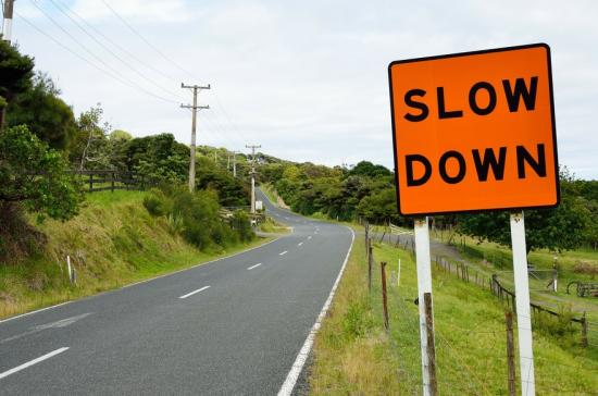 Slow down on road sign