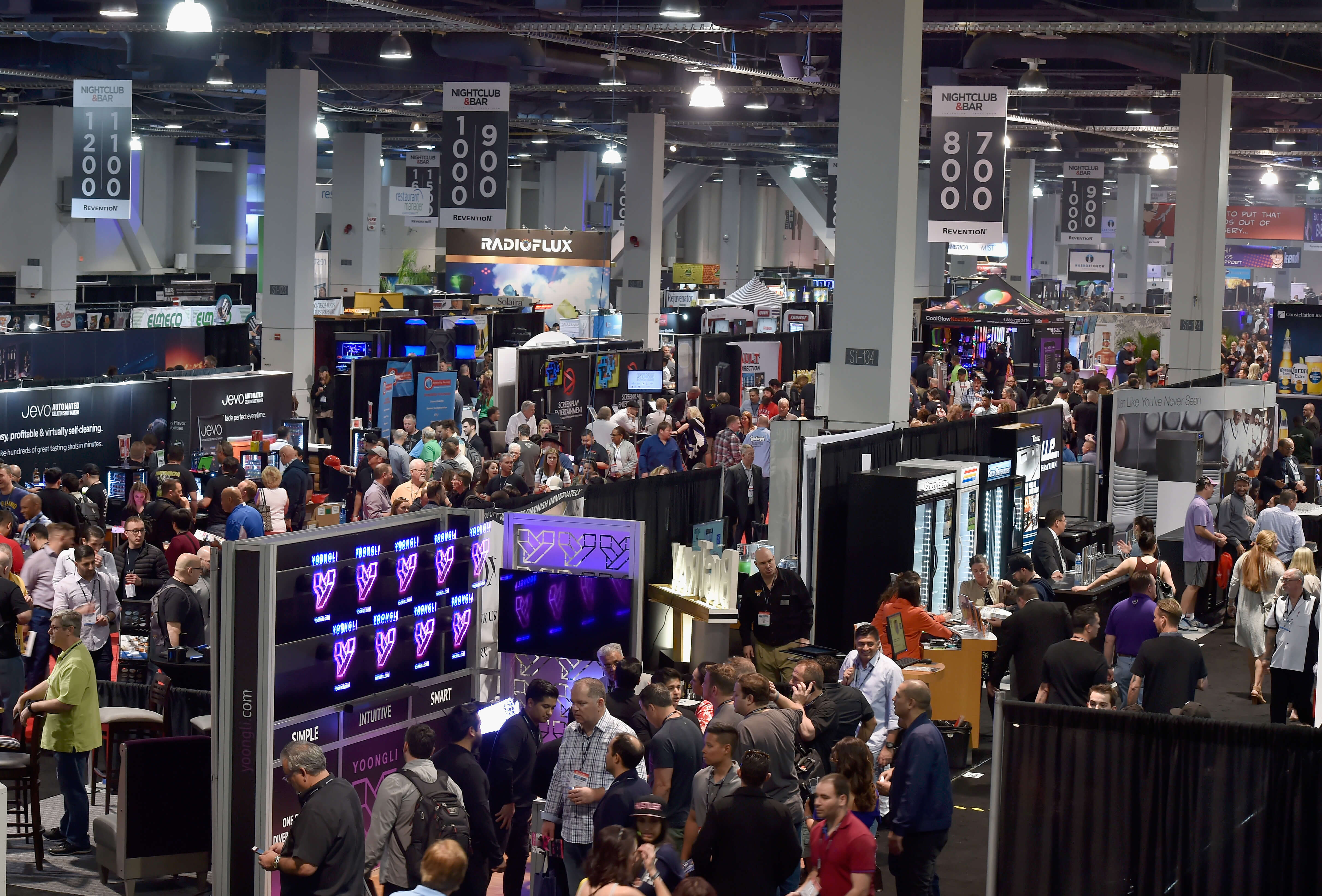 Nightclub and bar show 2020 sponsors   participants checking out exhibitor booths at the expo hall   nightclub and bar show 2020
