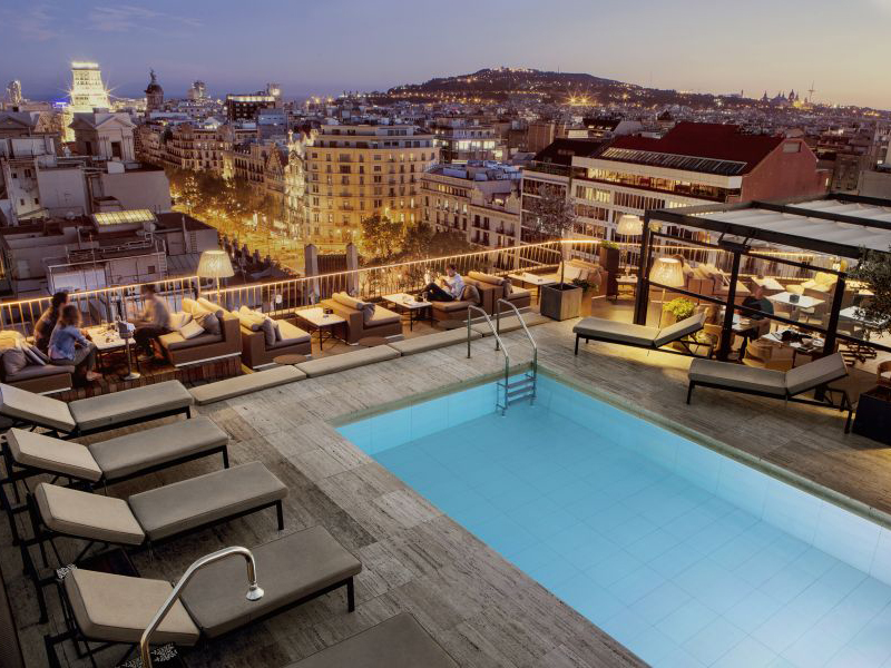 Seating around a rooftop pool