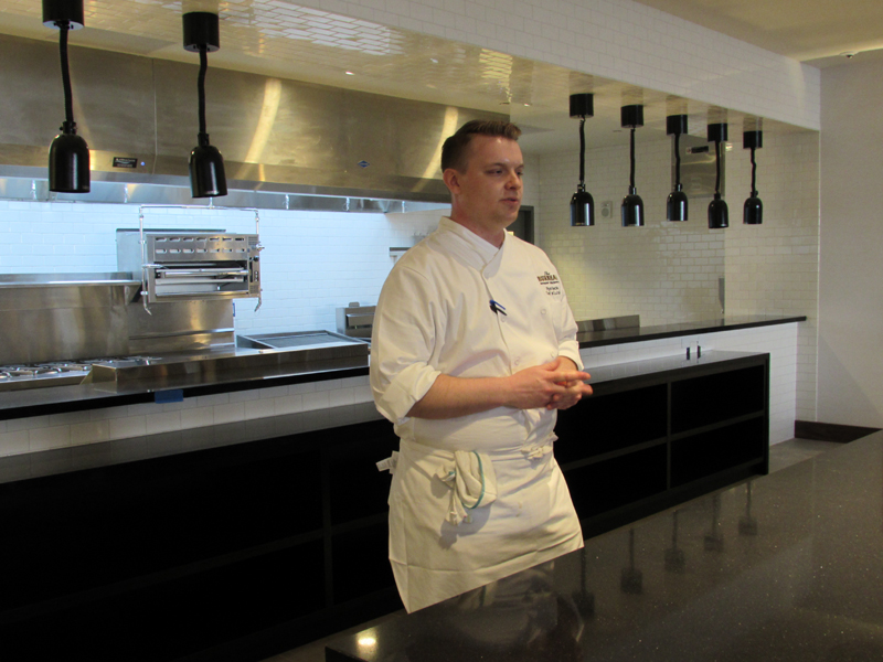 Chef stands in a kitchen