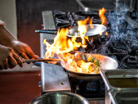 Chef cooking over stove