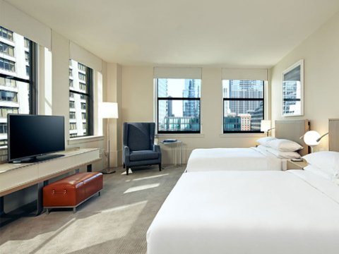 Hyatt Centric guestroom with bed, desk and TV