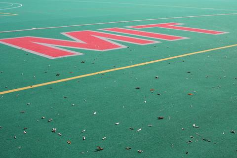 MIT written in the turf on a field