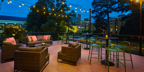 Outdoor patio with seating and lights