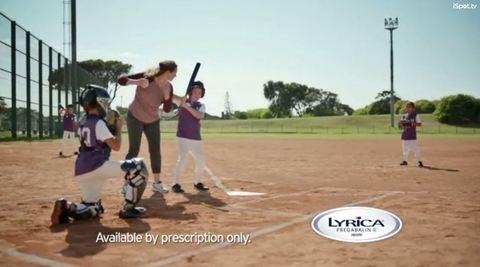 woman playing baseball with kids