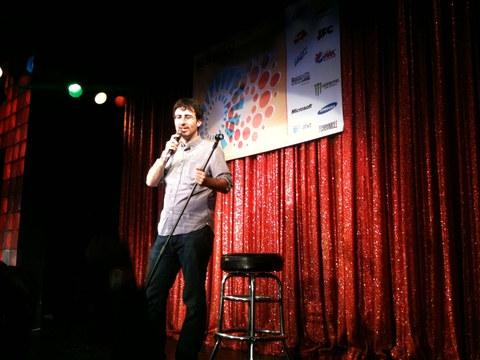 Man doing standup at comedy club