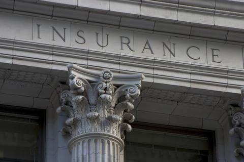 Pillar with insurance written on it