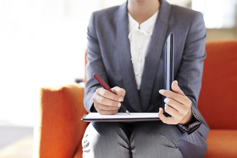 Photo of a young businessperson taking notes