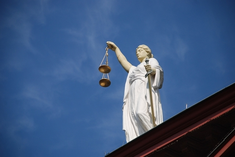 Statue holding judicial scales