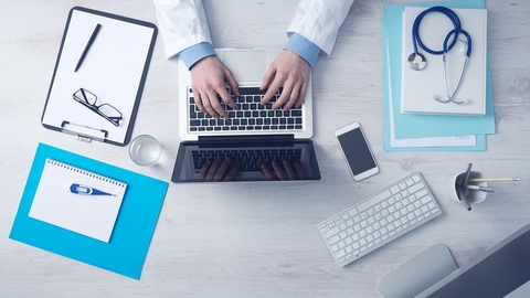 doctor on computer