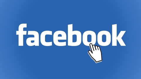 Small white hand pointing to the word 'Facebook'