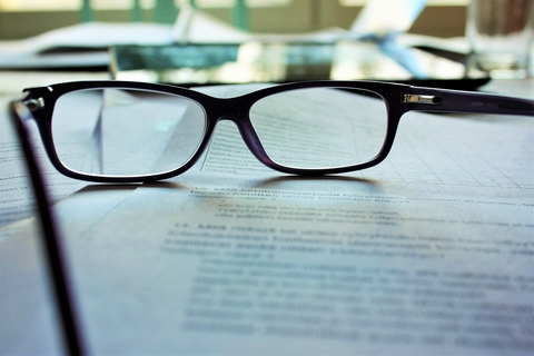 Glasses resting on a document