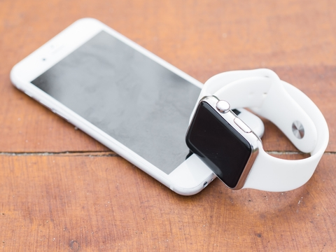 Photo of an iPhone and an Apple Watch