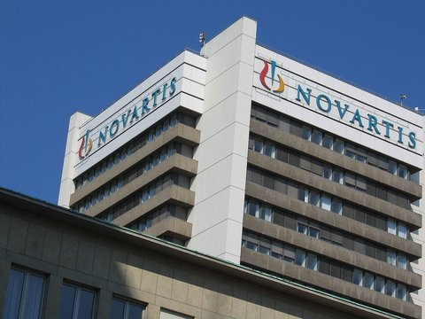 A large building with the Novartis logo on it