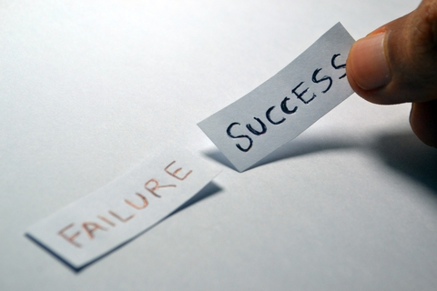 """Slips of paper that say """"Success"""" and """"Failure"""""""