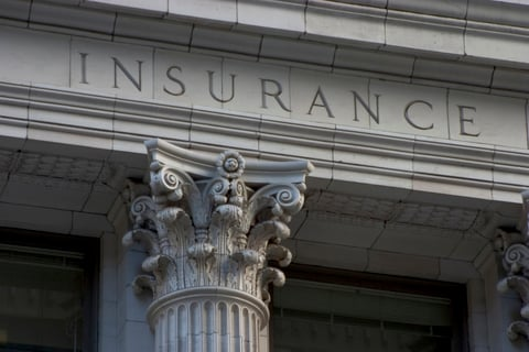 Pillar of building etched with the word insurance