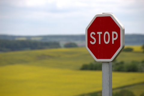 Stop sign in front of an empty field