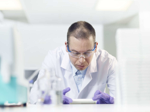 A researcher in a white lab coat