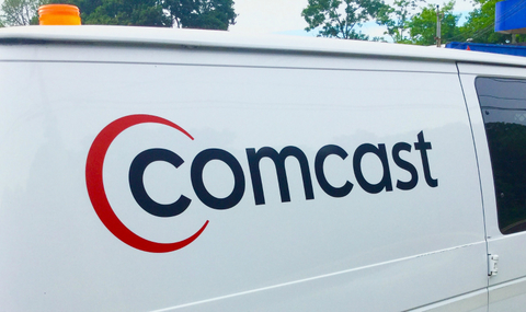 "Utility van with the word ""Comcast on the side"""