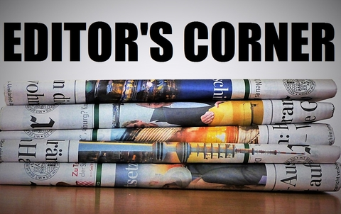 The words Editor's Corner in bold letters at the top of a stack of newspapers.