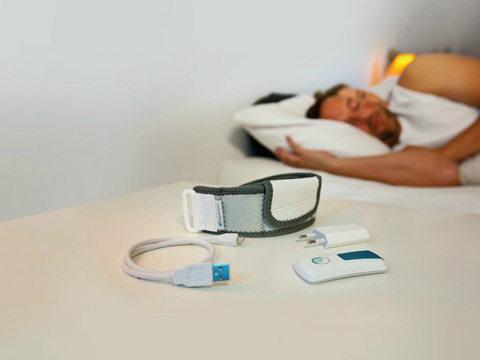 sleeping man and woman with device in foreground