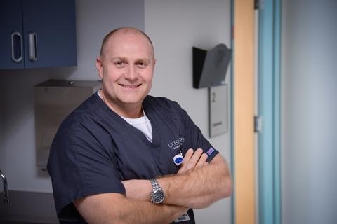 Mark Williams, nursing operations manager, Geisinger Shamokin Area Community Hospital, wears Geisinger's uniform for registered nurses.