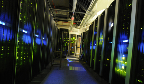 A dark room full of computer servers